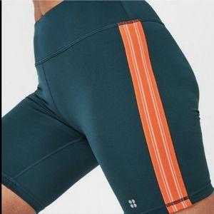 Sweaty betty contour biker shorts orange shorts